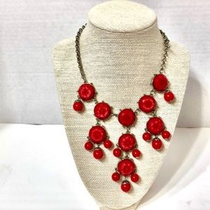 Silver tone necklace with  red beads